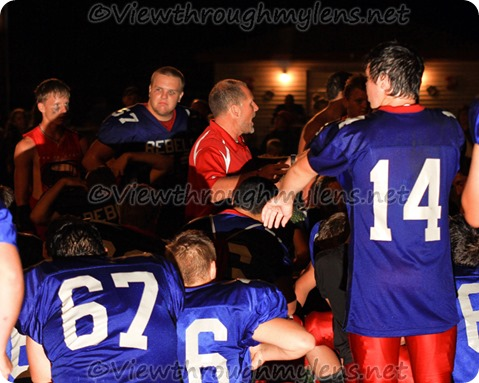 MLWR Coach Dave Louzek talk to his team after their victory Thursday night.