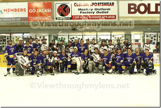 Cloquet and Dulut East alumni teams gather for a post-game photo.