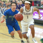 Cloquet's Tyler Moose drives by Blake School's Adam Goldenberg during Tuesday's Wood City Classic.