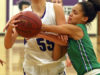 Cloquet's Carmen Foss draws a foul on Blake School's  Robbie Grace during the Wood City Classic game.