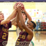 Duluth Denfeld's Tyrese Barnes and Ben Gibson grab a rebound in front of Pine City's Jake Rademacher.