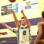 Pine City's Jake Lunceford shoots a 3-pointer vs. Duluth Denfeld