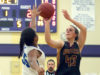 Duluth Denfeld's Tallie Boheim shoots over Blake School's Morgan Phillips during Wednesday's Wood City Classic game.