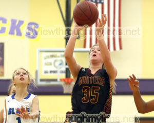 Duluth Denfeld's Elizabeth Emmel shoots vs. Blake School in the Wood City Classic.