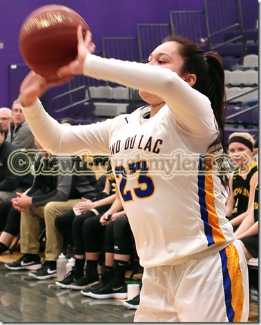Fond du Lac Ojibway School's Kayla Reynolds shoots a three-pointer durign the Wood City Classic game vs. Northwestern.